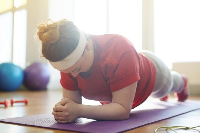 woman-doing-yoga-and-being-healthy
