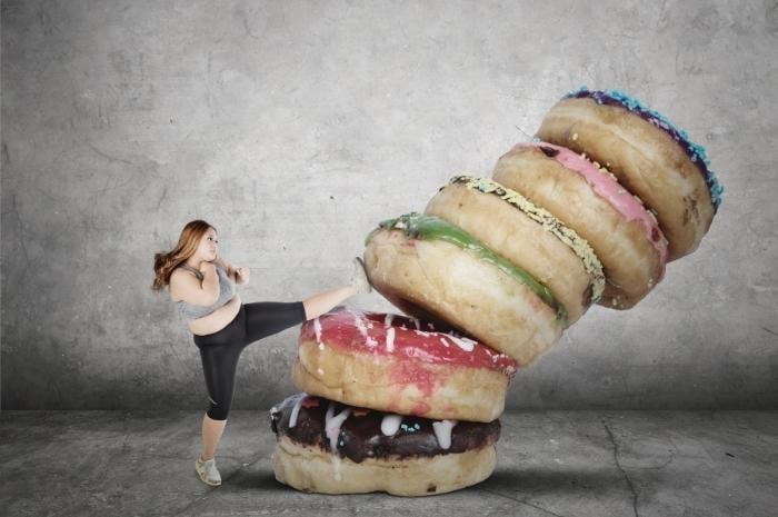 woman-kicking-the-sugar-donuts