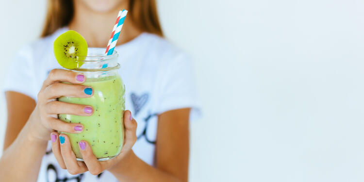 Assuaged-Woman-Drinking-Green-Smoothie-Image