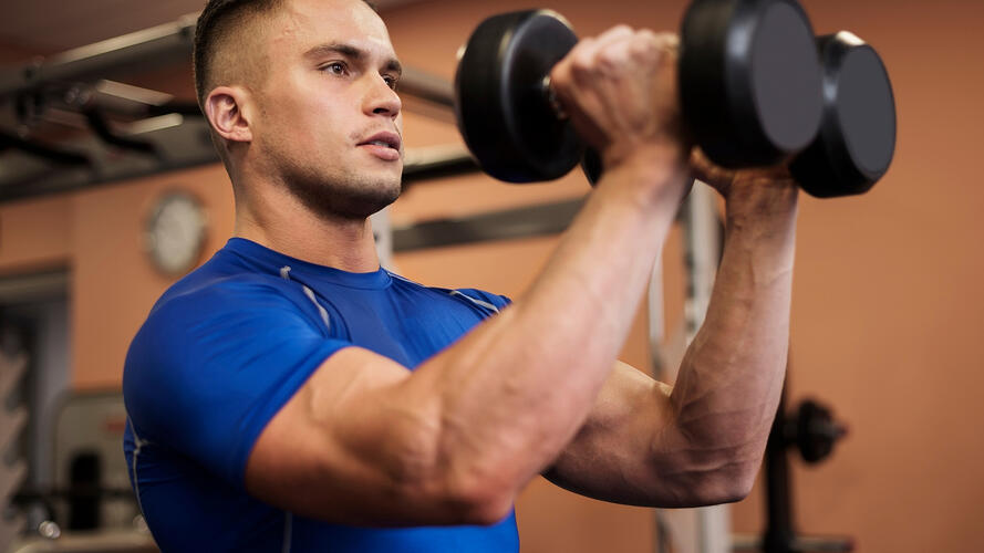 Assuaged-Man-Lifting-Dumbbells-Picture