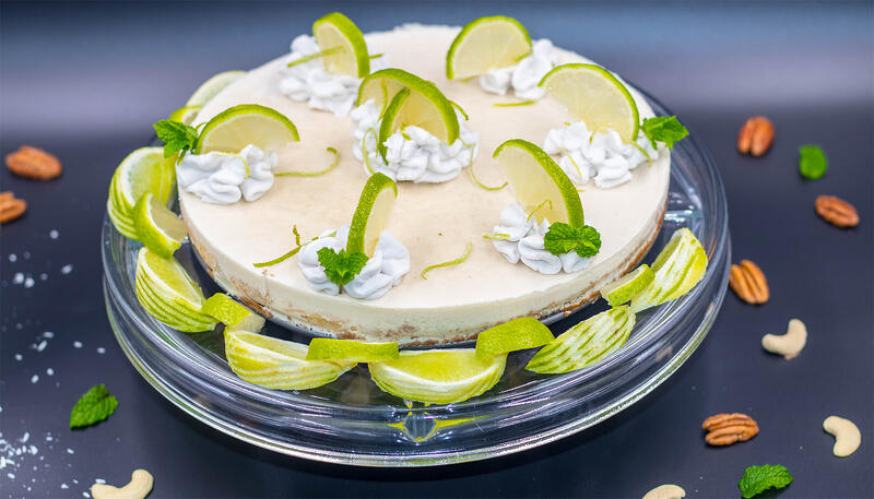 Keylime-Pie-with decorative fresh limes and vegan whipped cream dollops cashews and pecans