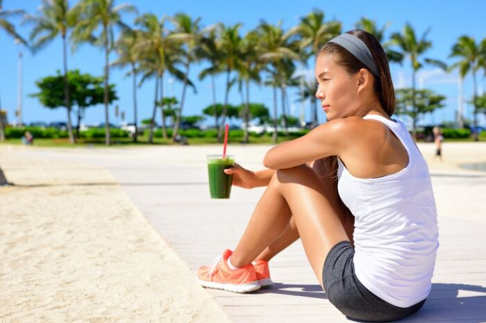 Copy of Pina-Colada-Superfood-Smoothie-girl-drinking-on-the-beach