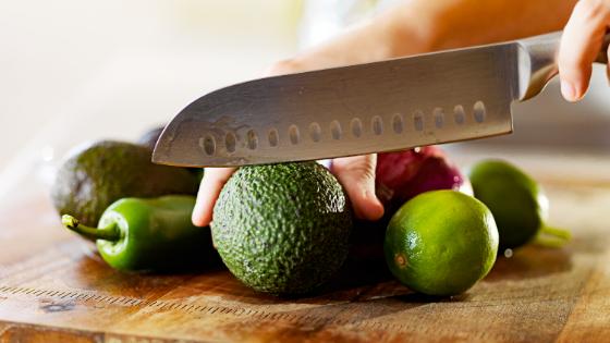 cutting avocado, limes, and jalapeños for quinoa salad