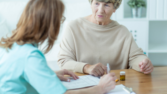 Doctor and Elderly Woman Discussing Healthcare Access to Plans