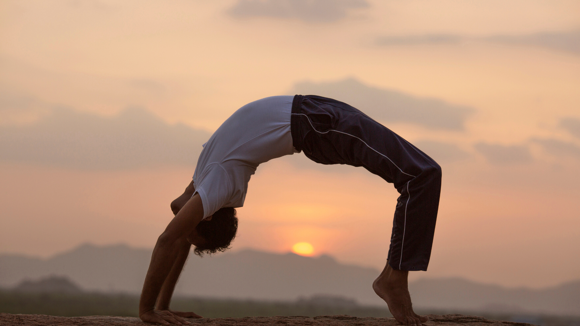 man doing yoga for mindful meditation
