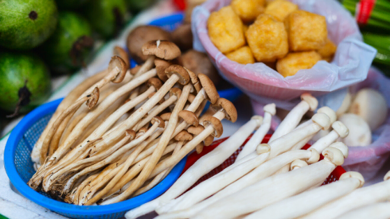 Enoki mushrooms with tofu in background