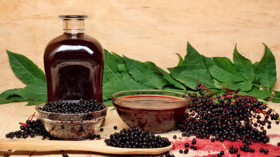 fresh squeezed elderberry juice with raw elderberries
