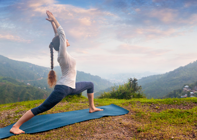 woman doing yoga in forest for health