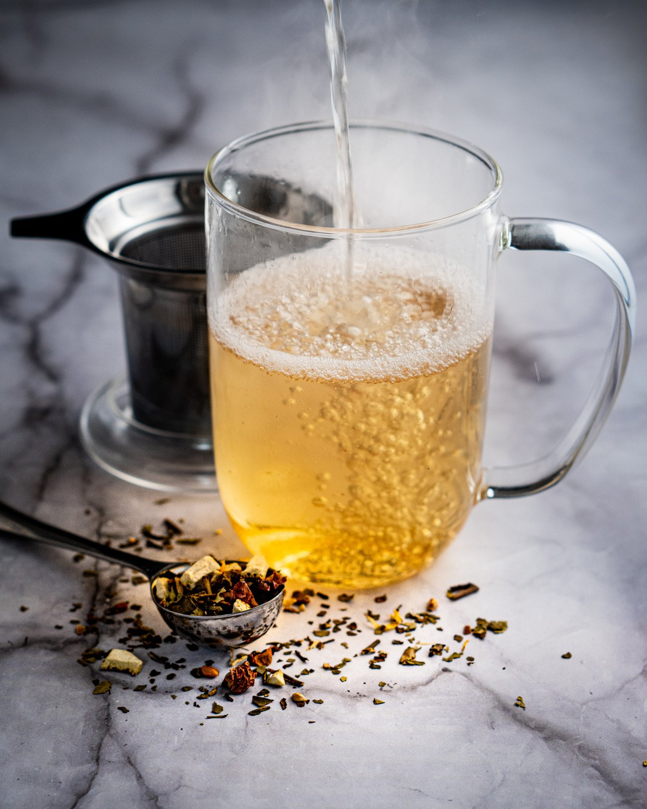 canva-fresh-brewed-tea-served-on-table-with-spoon-of-dry-herbs-MAEIjw-0Wdk