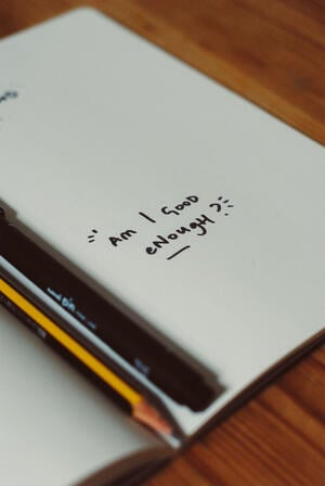 Am I good enough? written in notebook